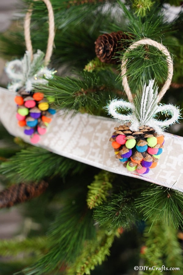 Colorful pinecone ornaments displayed on a Christmas tree