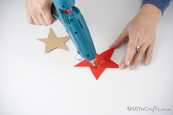 Gluing stars together for a Christmas star decoration