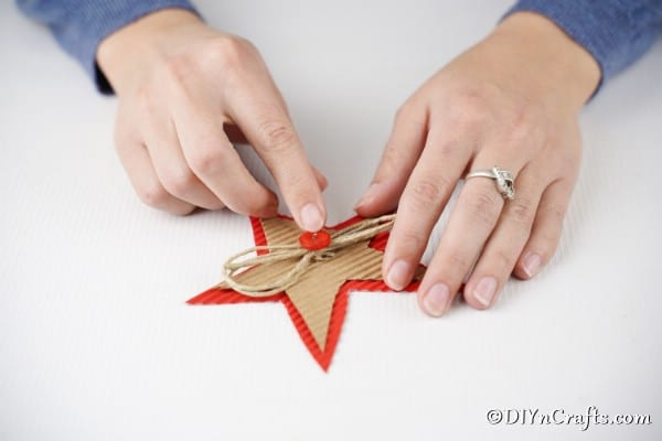 Adding a red button inside the bow on a Christmas star