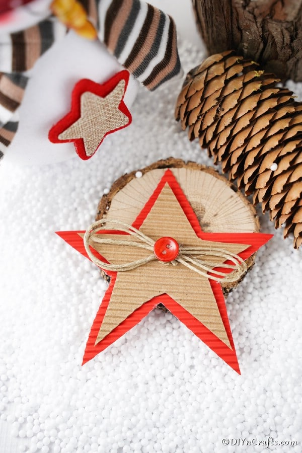 A cardboard Christmas star decoration laying on a white surface