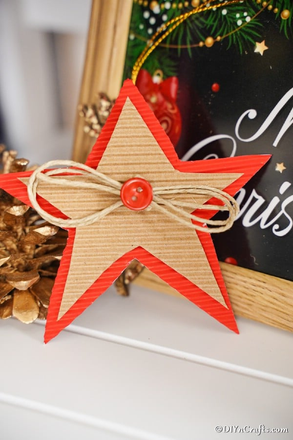 A cardboard Christmas star decoration next to a holiday sign