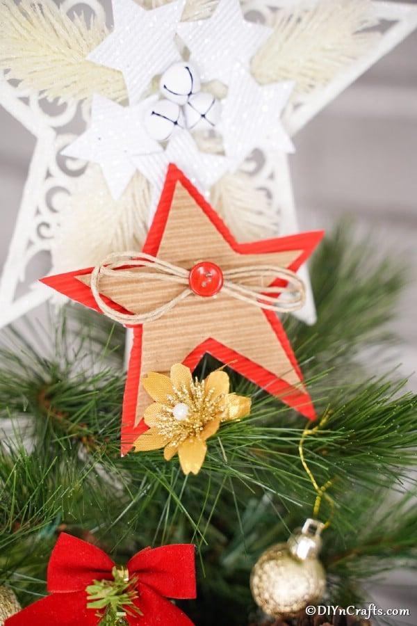 A cardboard Christmas star decoration on a tree