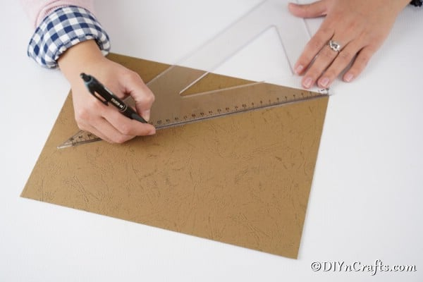 Tracing the arc on a piece of cardboard