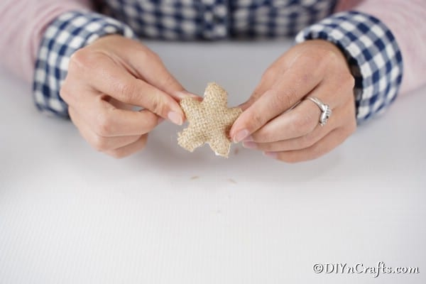 Covering the styrofoam star with burlap for your pasta christmas tree