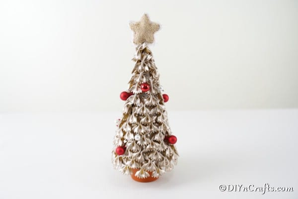 A finished Christmas tree from pasta displayed on a white surface