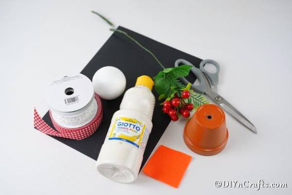 Supplies needed to make a snowman decor for Christmas