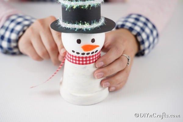 Adding scarf to snowman body