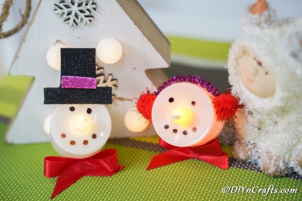 Close up picture of snowman and santa christmas candles