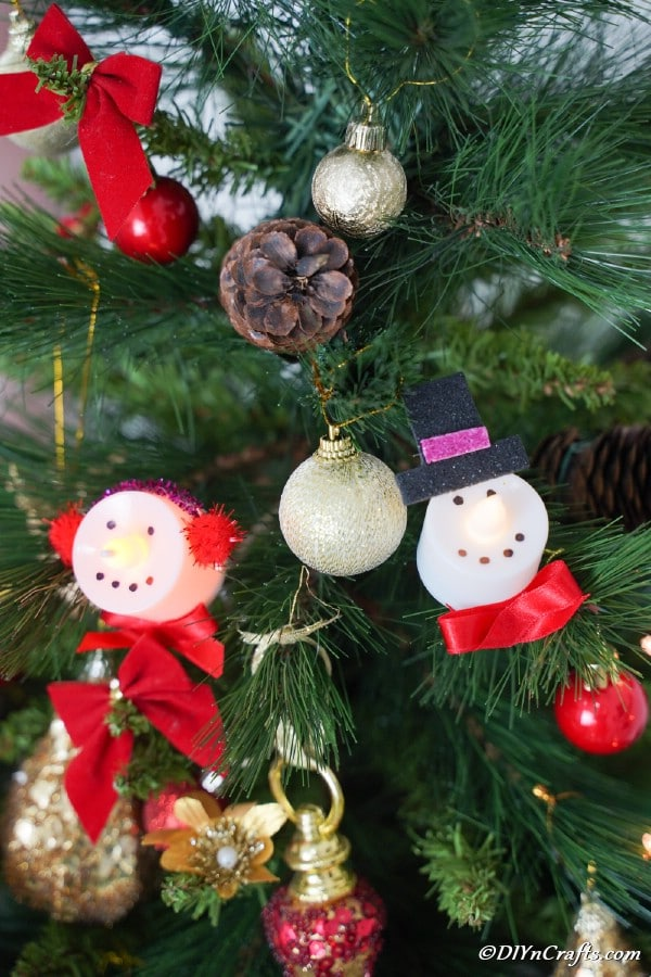 Santa and Snowman Christmas candles on a holiday tree