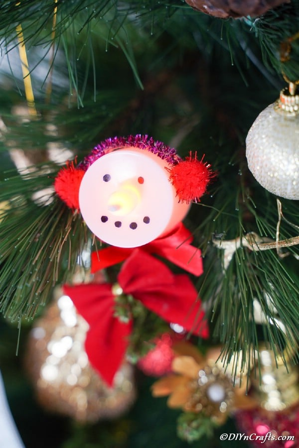 A close up picture of a Santa Claus Christmas candle hanging on a tree