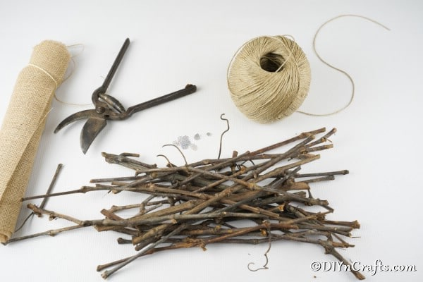 Supplies needed for making a rustic Christmas ornament