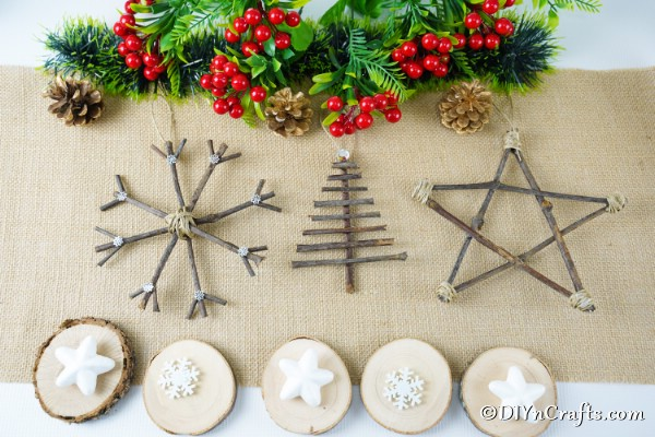 Three rustic Christmas ornaments on a piece of burlap