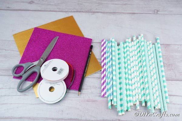 Supplies needed to make a paper Christmas tree out of paper straws