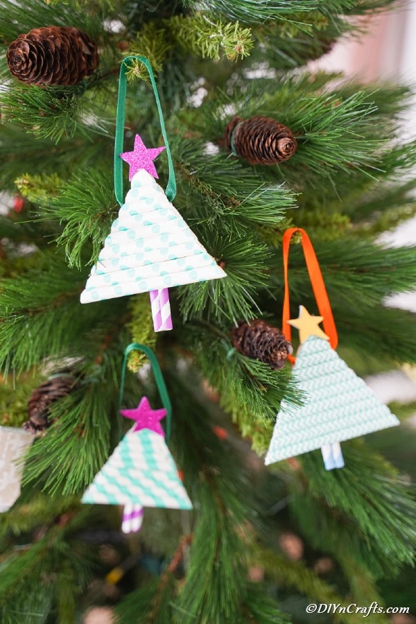 Ornaments made from paper straws hanging on the Christmas tree