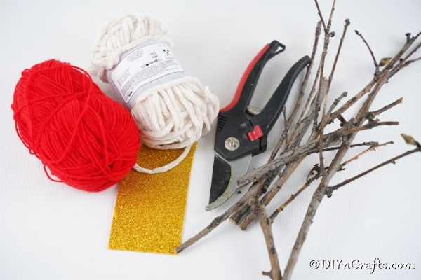 Supplies needed to make twig rustic ornaments for the Christmas tree