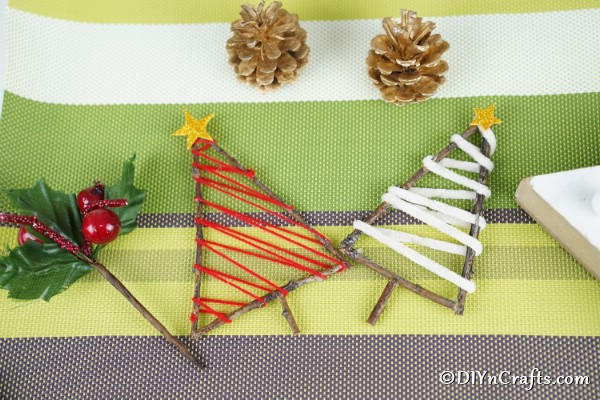 Twig rustic ornaments on a green and white surface