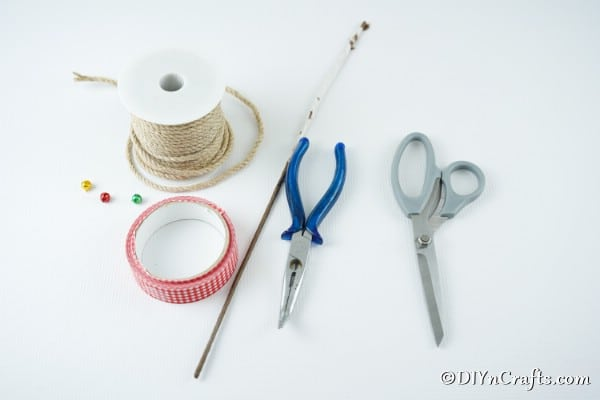 Supplies for making rustic wrapped candy cane ornaments