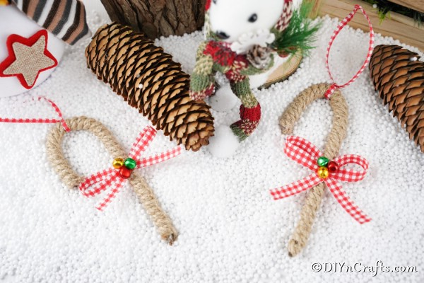 Candy cane ornaments laying on a white surface
