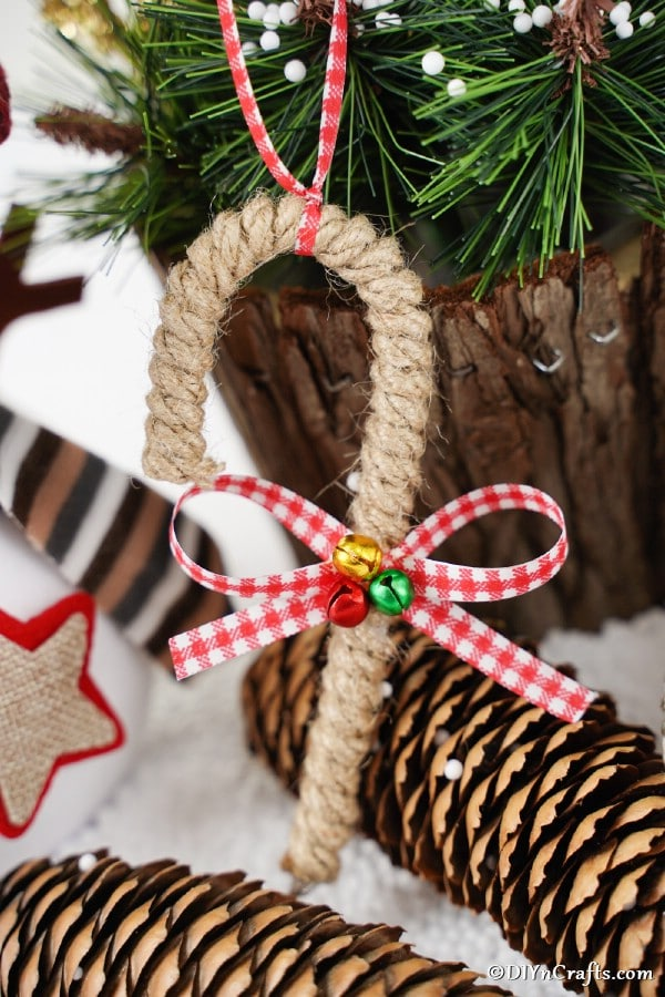 Up close picture of a rustic twine wrapped candy cane ornament