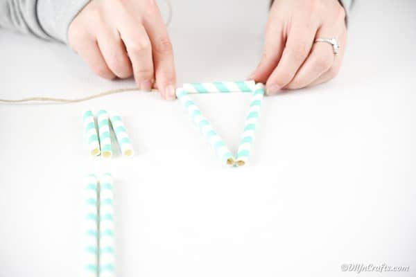 Adding paper straws to twine