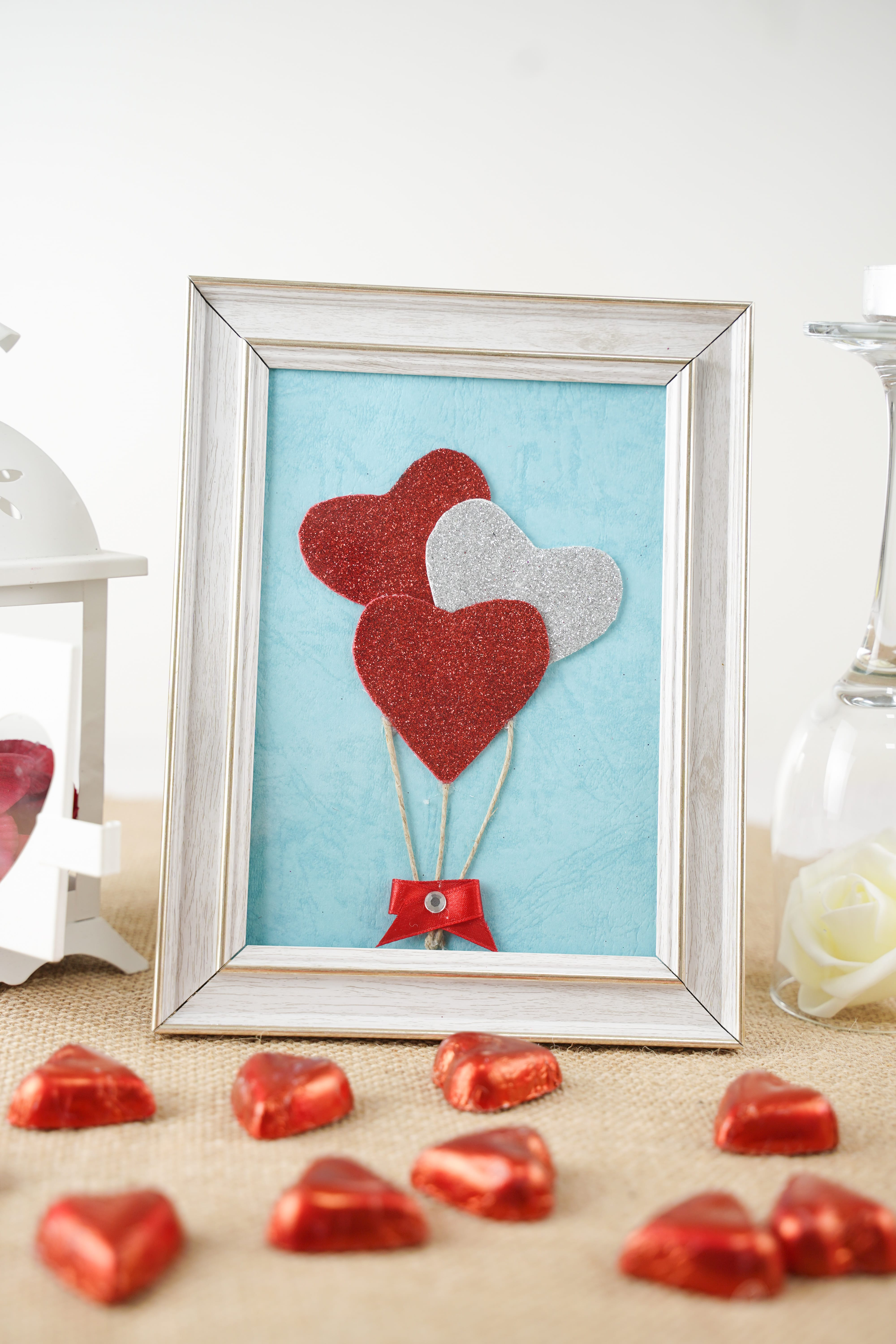 Framed hearts on table with Valentine's Day decorations