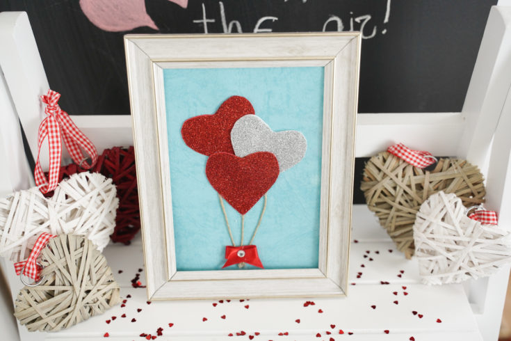 Framed hearts decoration in front of chalkboard