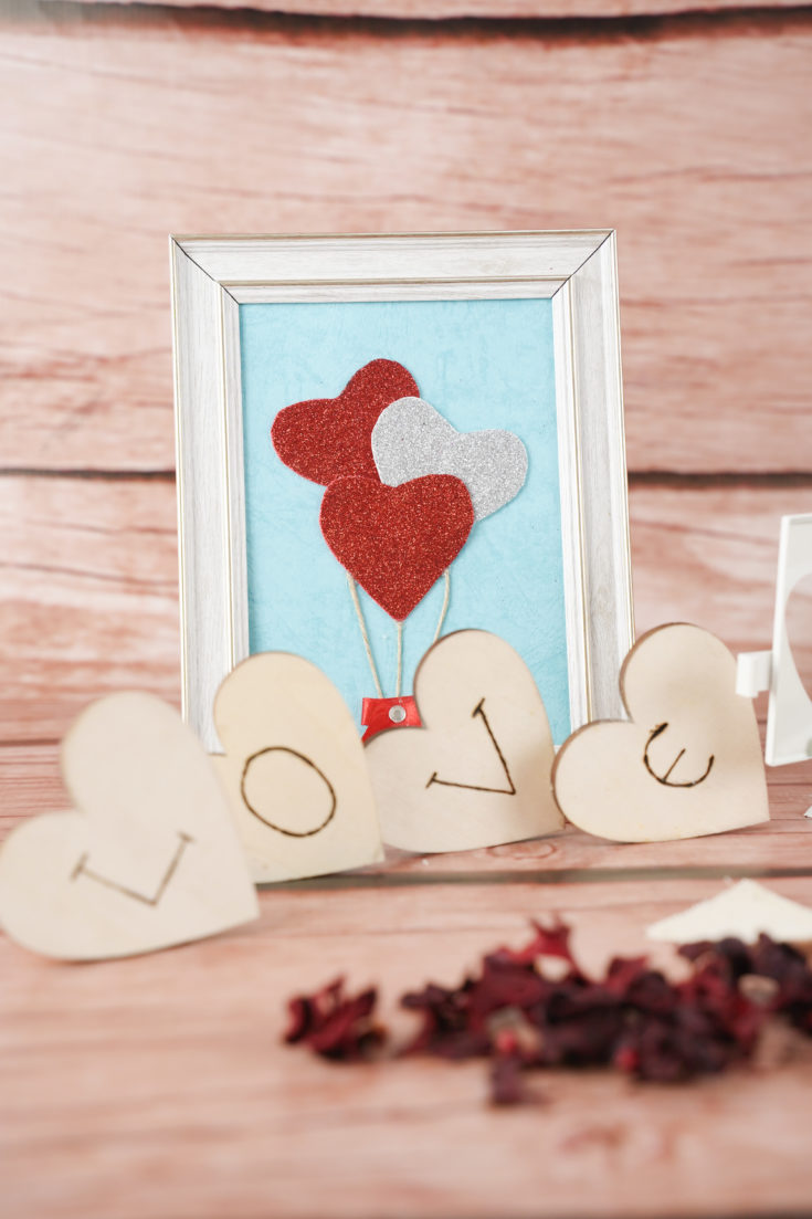 Framed hearts decoration with hearts spelling love in front