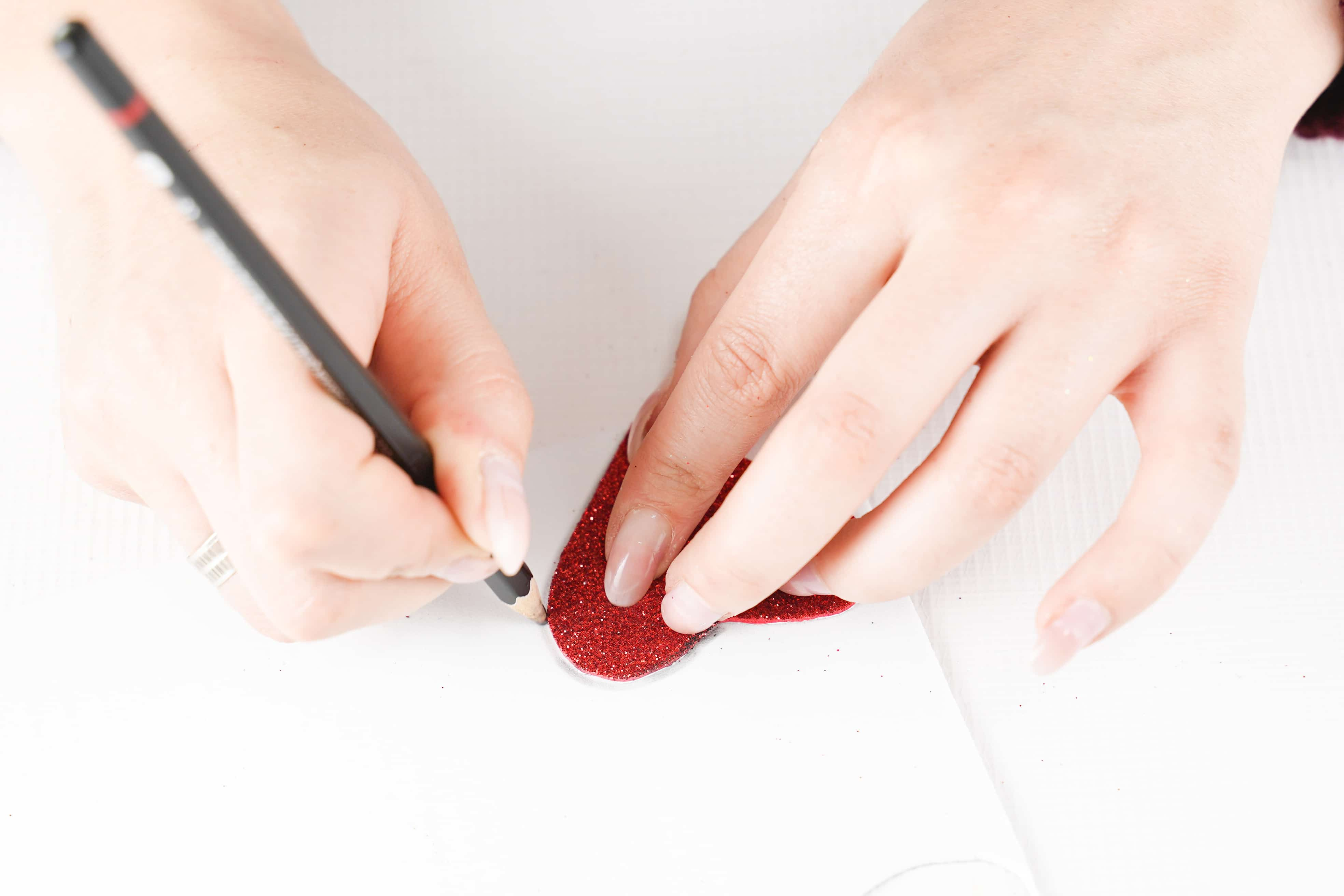 Tracing a heart onto paper for a template