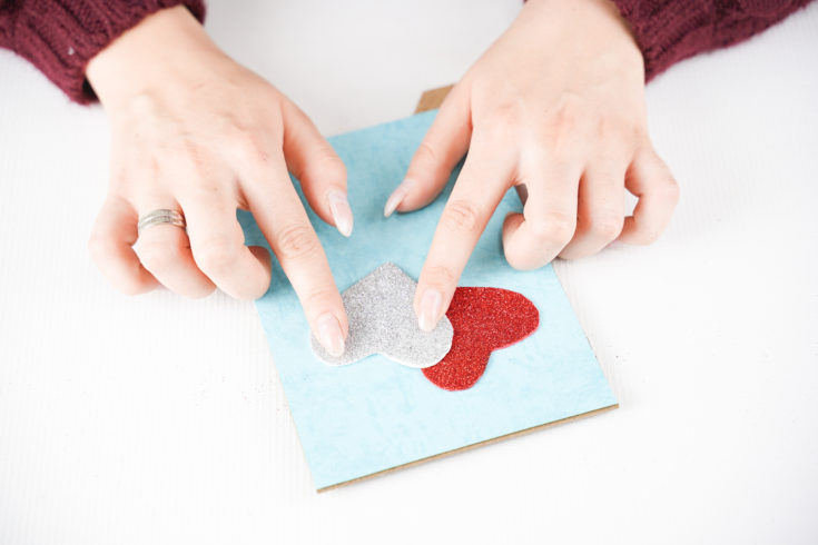 Adding hearts to front of blue paper