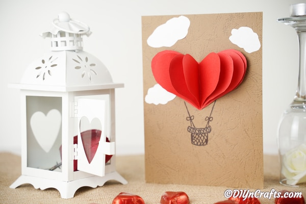 3D Valentine's day card on a table with white lantern