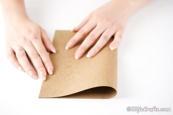Folding brown craft paper in half