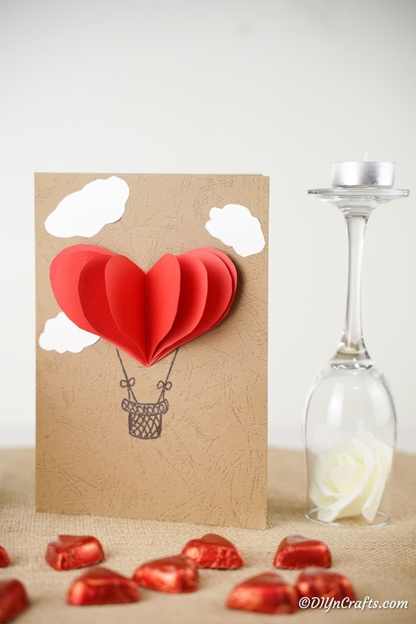 Hot air balloon card next to wine glass