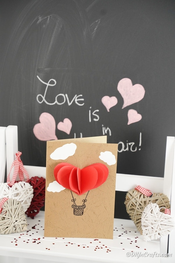 3D Valentine's Day card in front of chalkboard