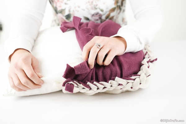 Stuffing the pillowcase with a throw pillow