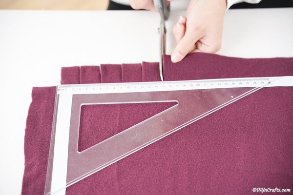 Cutting slits in fabric for creating loops to attach