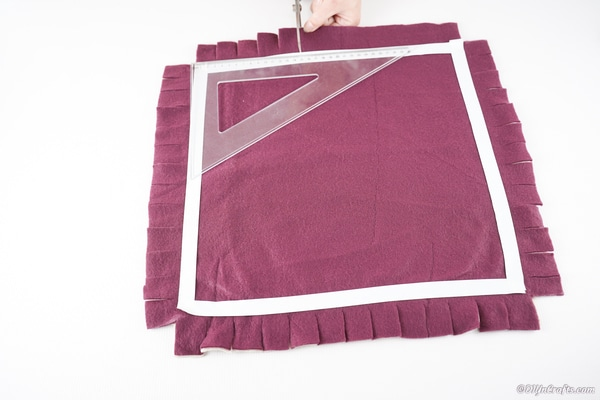 Square of fabric with fringe cut on the outside