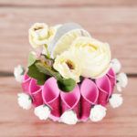 Overhead picture of paper flower basket on wooden table