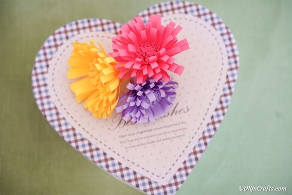 Paper flowers on top of heart box
