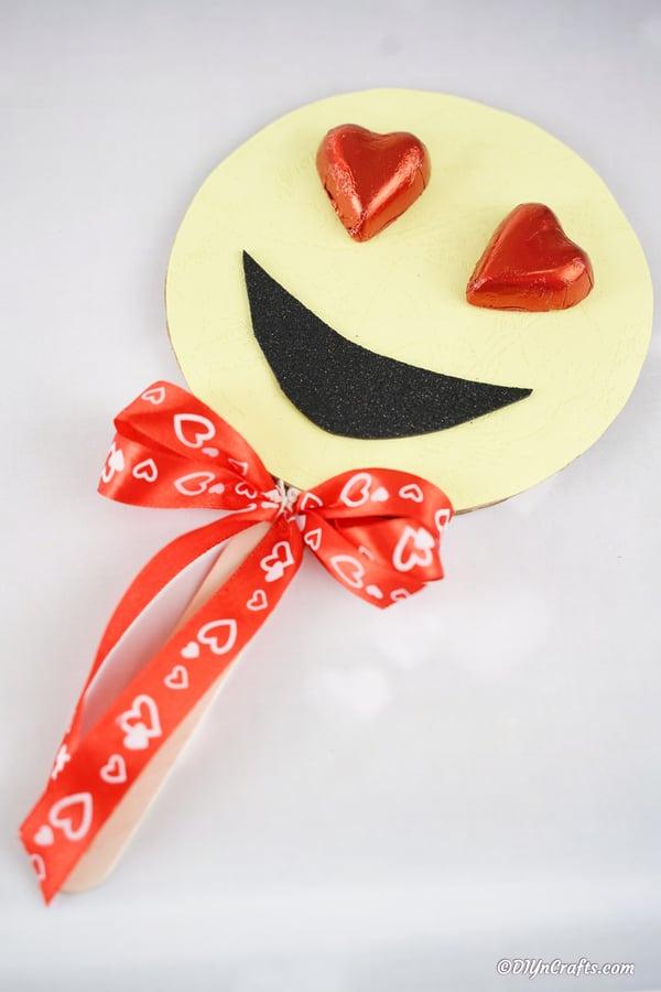 Heart eye smiley emoji on white surface