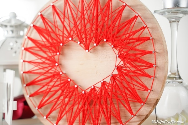 Heart string art on wooden board