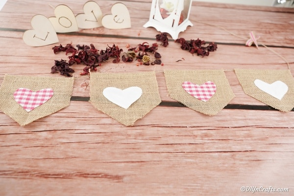Valentine burlap garland with red and pink hearts on wood table