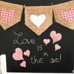 Valentine banner against chalkboard