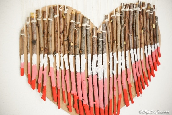 Close up painted twig heart on wall