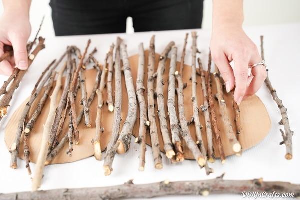 Measuring twigs against heart shape cardboard
