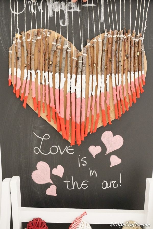 Twig heart decoration against chalkboard