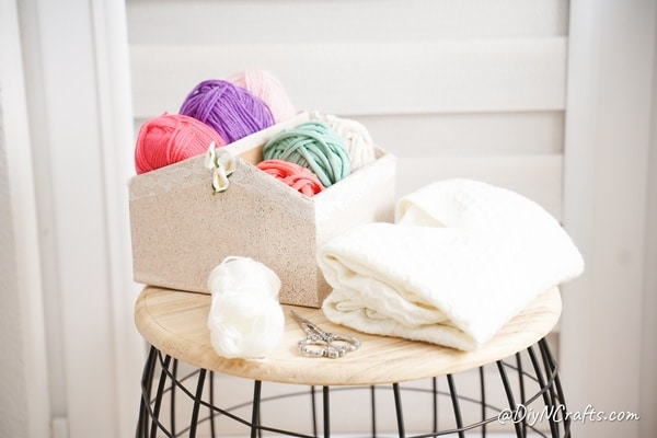 Organizer box filled with yarn on table