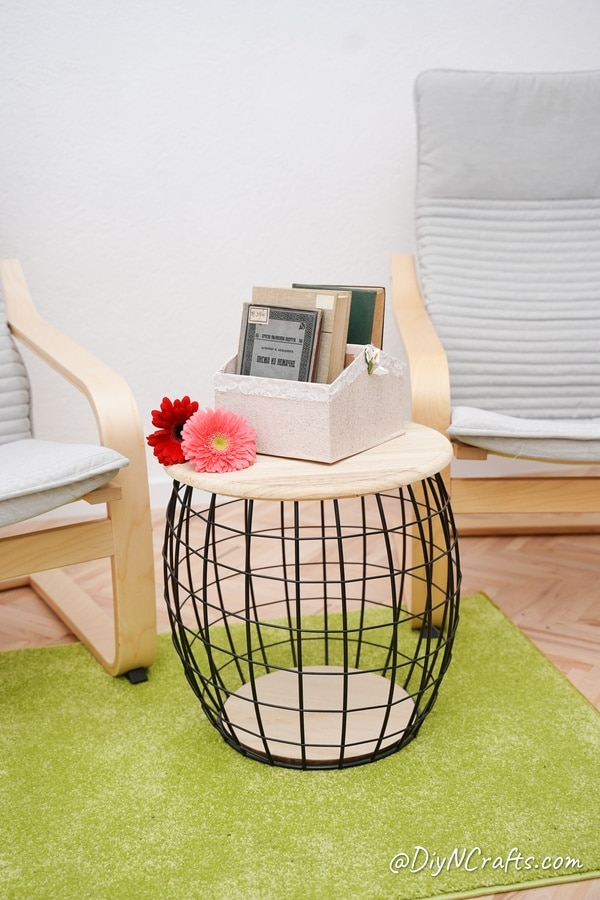 Cardboard box of books on wire and wood side table