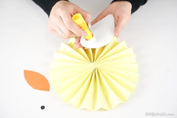 Gluing wing to paper fan circle