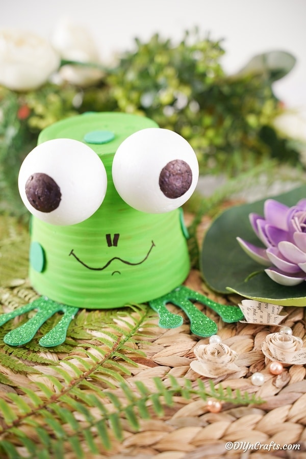 Frog craft sitting on fern fronds