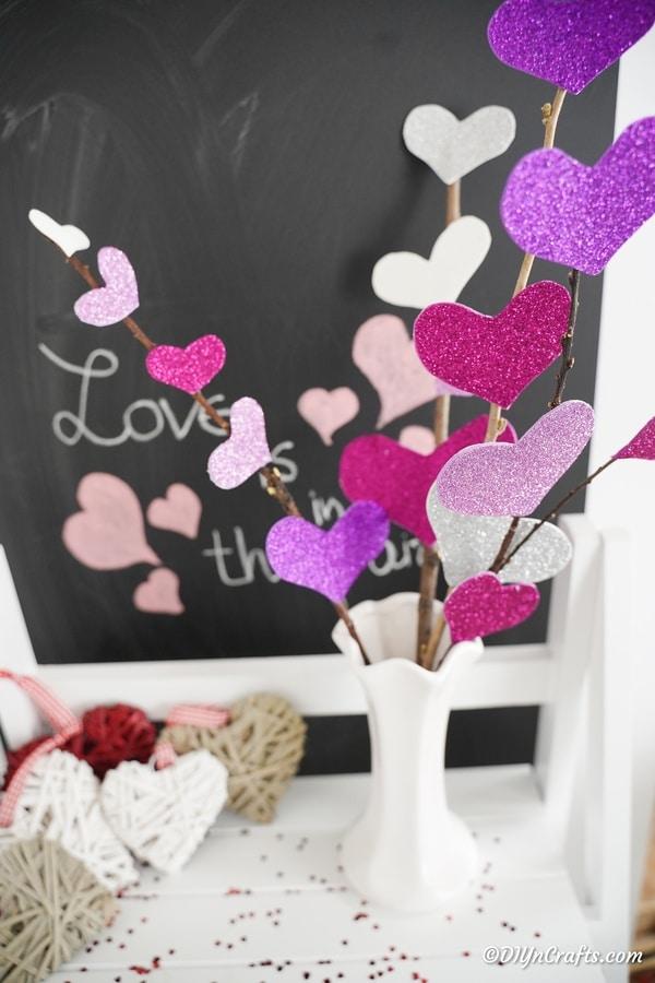 Heart flower bouquet on shelf in front of chalkboard